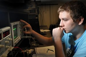 electronic student working at a switchboard