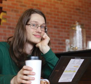 take online classes virtually anywhere, a student in a coffee shop on a computer