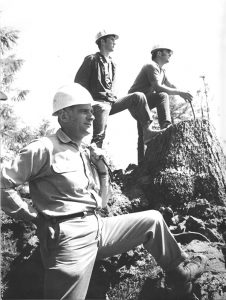 RCC history- loggers posing on cut trees