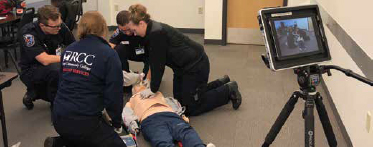 ems students in training with video simulation tools