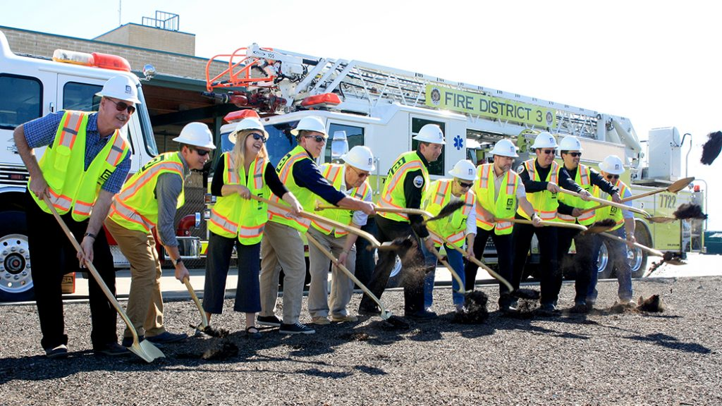 RCC and Fire District 3 officials throw dirt at the groundbreaking ceremony of the new Educational Center.