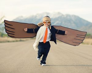 boy with wings on a road