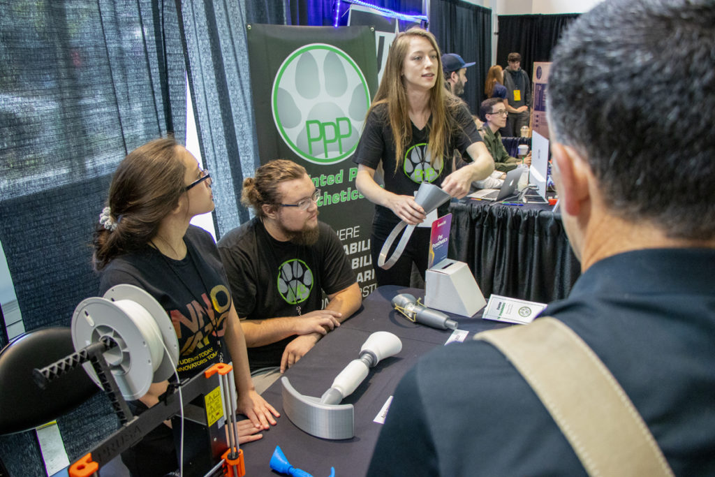 Student innovators from Rogue Community College display their prototype for a pet prosthetic at the 2019 InventOR Innovation Challenge in Portland.
