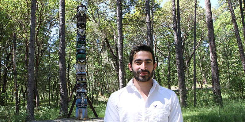 Student worker Alexis Gonzalez Olivo wrote a successful grant application to install a sign at the Redwood Campus totem pole honoring pioneering chain saw artist Don Colp who carved the sculpture in 1990.
