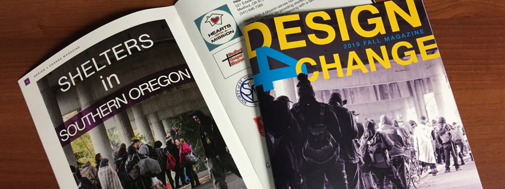 Two copies of Design 4 Change magazine lay on a table
