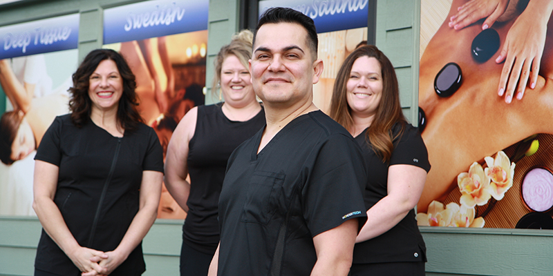 Armando Garcia and his team of licensed massage therapists stand outside River Stone Massage & Wellness in Grants Pass.