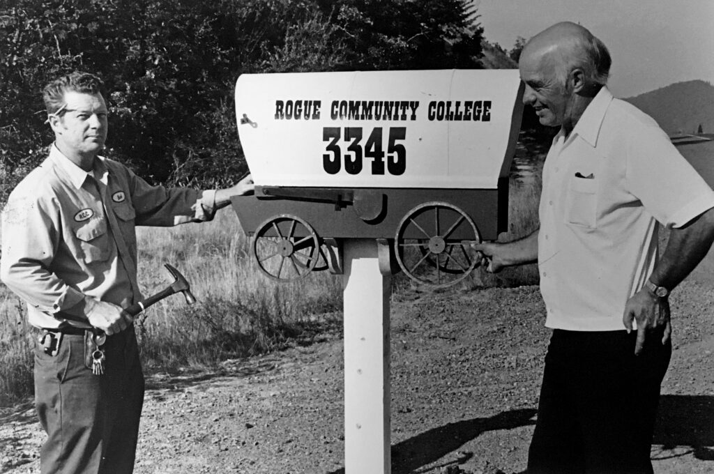 RCC's first president Henry Pete (right) and Robert Duesslier, a carpenter and maintenance worker,  erect a mailbox near Redwood Highway at the entrance to the new community college.