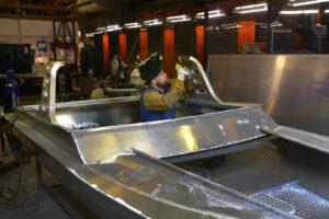 A man welding an aluminum boat